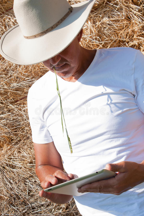 Download Cowboy Using Tablet Computer Stock Image - Image: 25345485