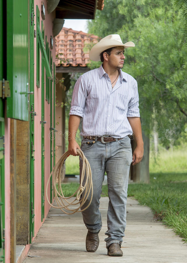 Cowboy walking. With a lasso royalty free stock photography