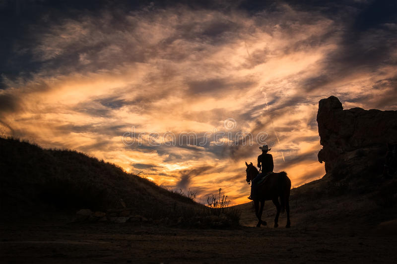 Cowboy Watching Sunset. A cowboy watches the sunset in the hills of California royalty free stock photography