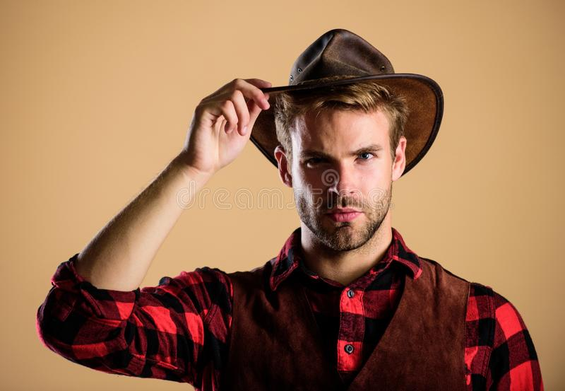 Cowboy wearing hat. American cowboy. Beauty standard. Example of true masculinity. Western life. Man unshaven cowboy stock images