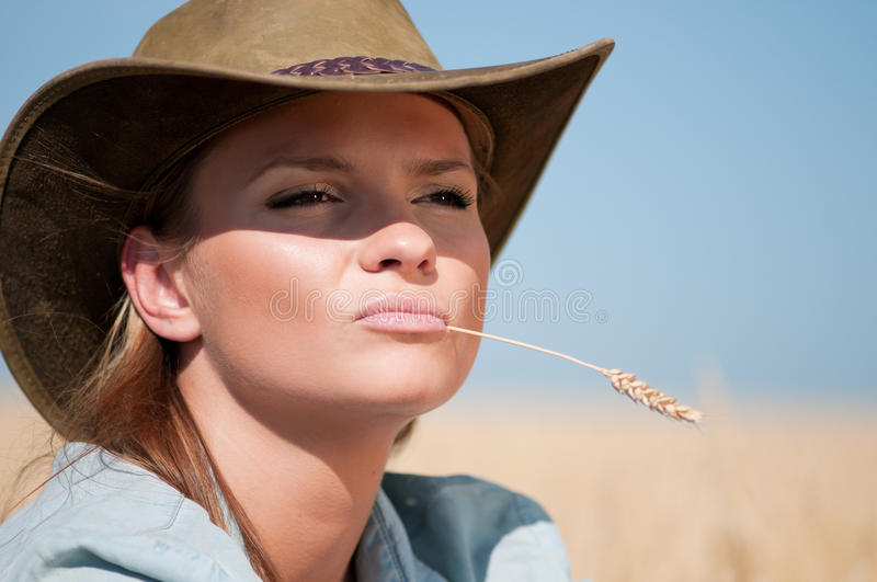 Download Cowboy Woman In Country Wheat Field Stock Photo - Image of girl, outdoor: 17726218