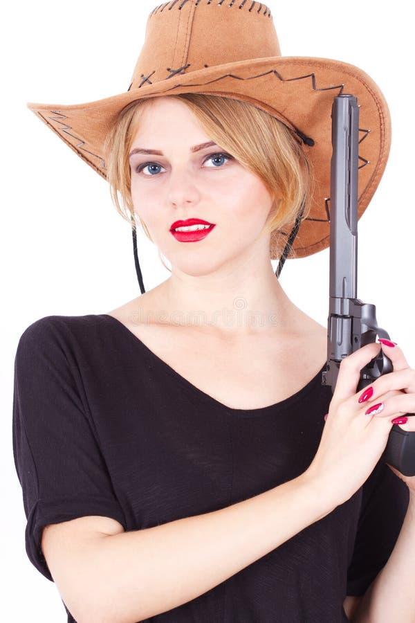 Cowboy woman holding a big gun royalty free stock image