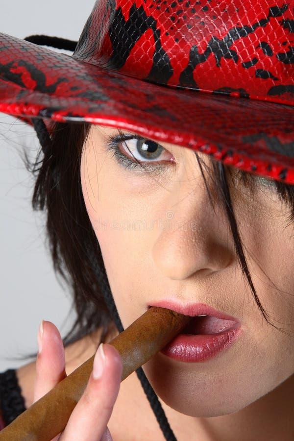 Cowboy Woman Smoking Cigar Royalty Free Stock Image