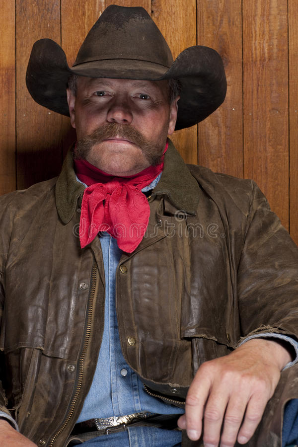 Cowboy By a Wood Wall stock image