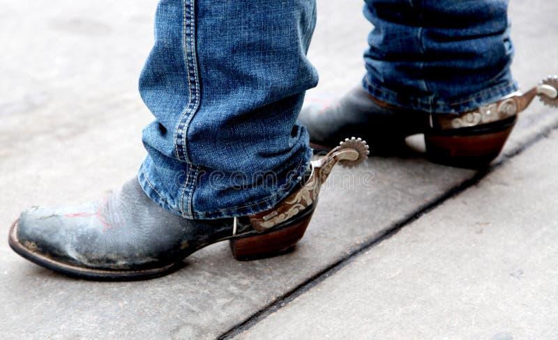 Cowboyen Boots med rostad silver sporrar royaltyfria bilder