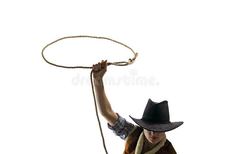 Cowboyen kastar en isolerad lassovit royaltyfri foto