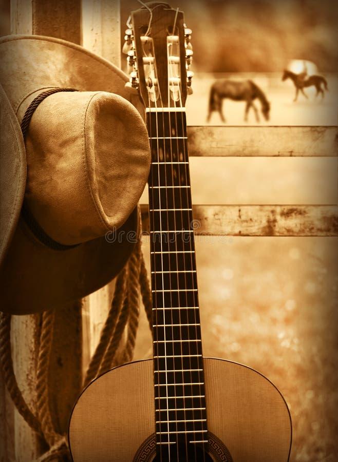 Cowboyhatt och gitarr Amerikansk musikbakgrund royaltyfri bild