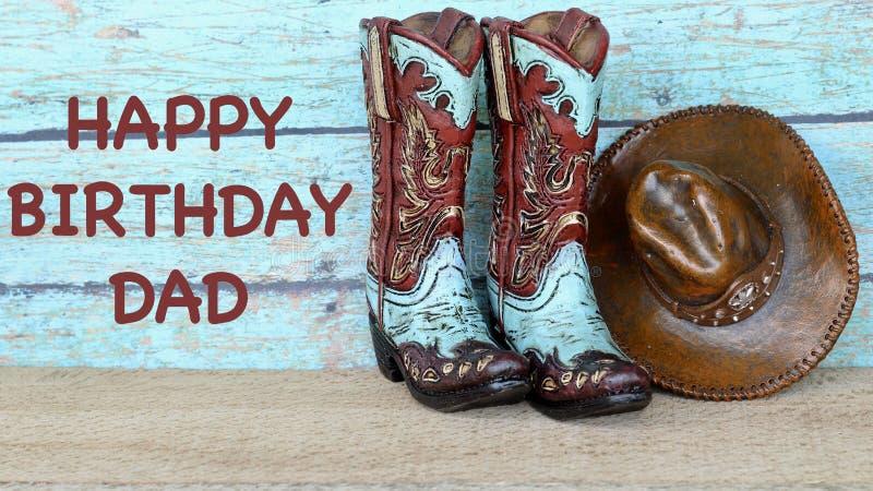 Cowboyk?ngor och hatt p? en krickabakgrund royaltyfria bilder