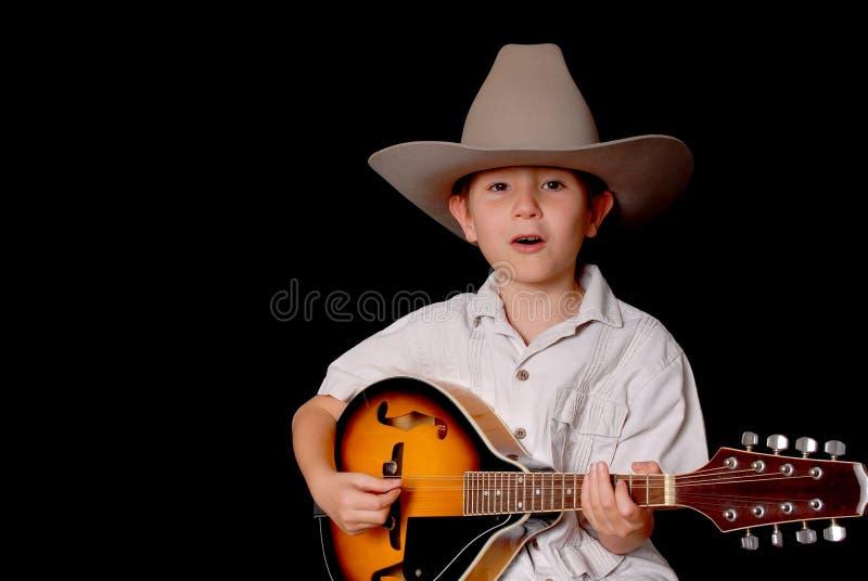 cowboymusikerbarn arkivbild