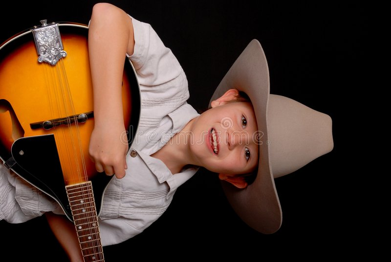 cowboymusikerbarn fotografering för bildbyråer