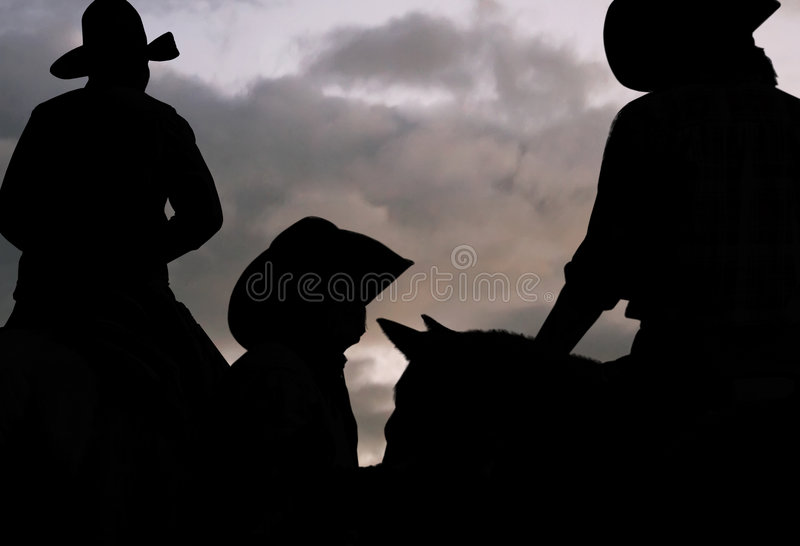 Cowboys Early Morning Roundup. Cowboys waiting for daylight to start their early morning cattle roundup stock photos