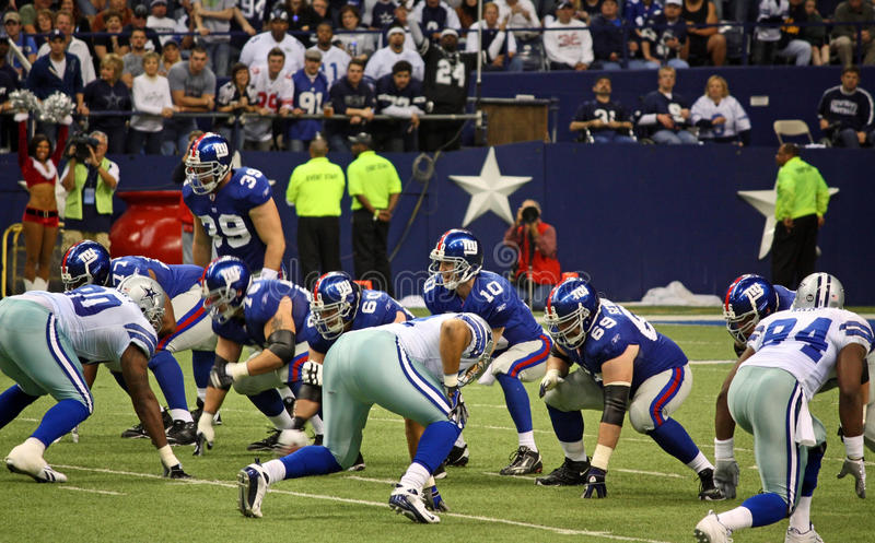 Cowboys and Giants with Eli Manning royalty free stock photos
