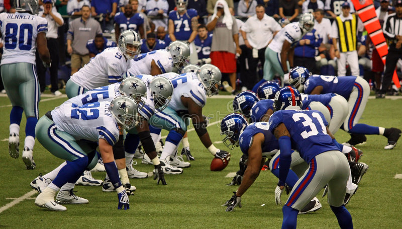 Cowboys and Giants Line Up royalty free stock photography