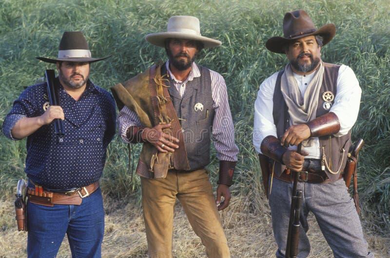 Cowboys im vollen Kostüm während der Grenze reenactment+B3 stockfotos