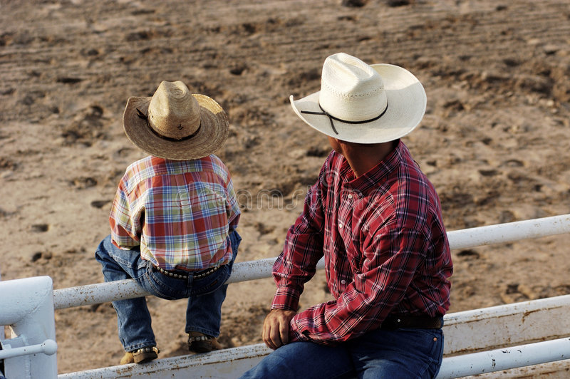 Cowboys, jong en oud stock afbeelding