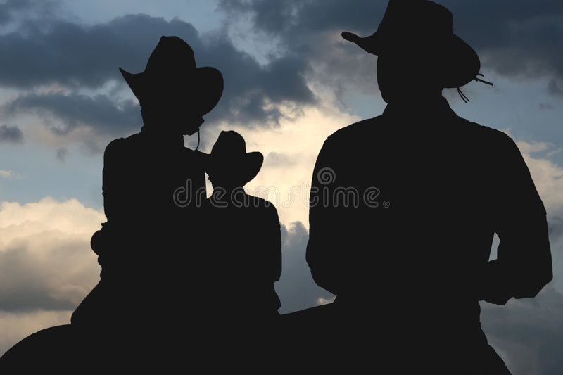 Cowboys In The Morning Silhouette Stock Photo