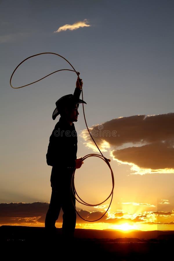 Cowboyschattenbild roping stockbilder
