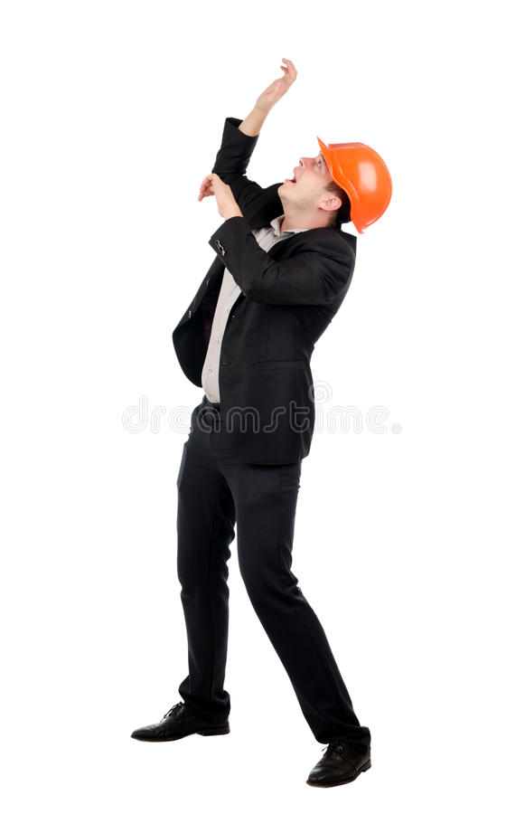 Cowering Man Wearing Suit and Hard Hat. Man Wearing Suit and Hard Hat Cowering as if Threat from Above, in Studio with White Background stock images