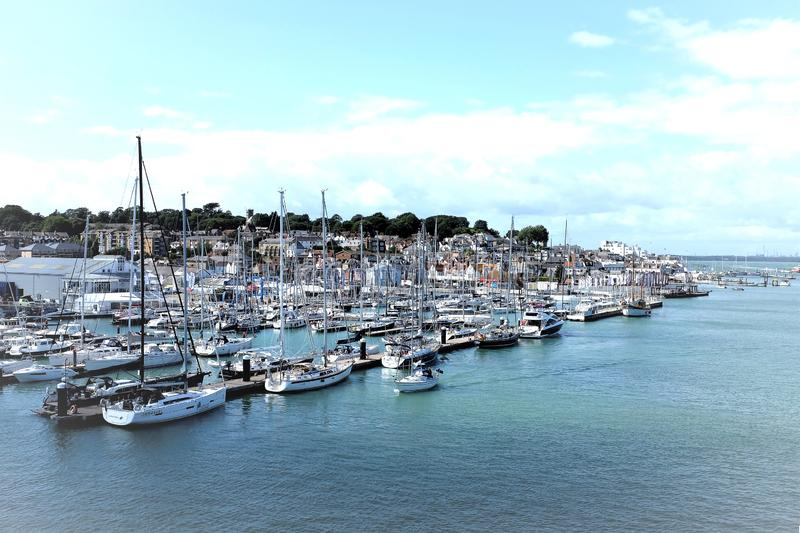 Cowes Yachting, Isle of Wight, UK. Cowes, Isle of Wight, UK. August 18, 2019. Sports people mooring Yachts and boats in the Marina of the yachting capital of the stock image