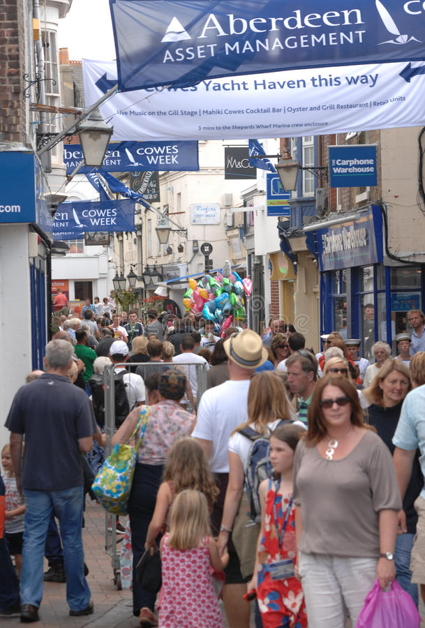 Cowes week tourists. Crowds in the small sailing port town of Cowes during the acclaimed sporting event the annual Cowes international yacht regatta. Isle of royalty free stock images