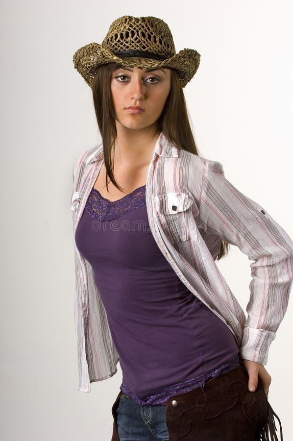 Cowgirl adolescente na parte superior e no chapéu de tanque imagem de stock