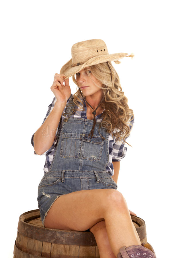 cowgirl on barrel overalls serious tip hat stock images