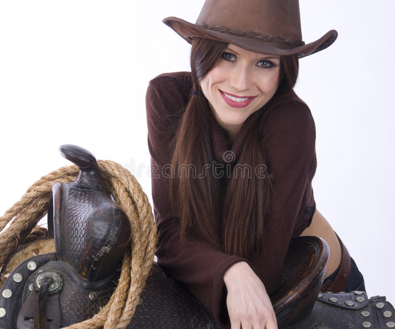 Cowgirl Candid Smiling Female Poses on Saddle royalty free stock photos