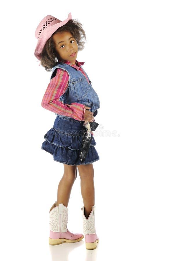 Cowgirl che guarda indietro immagine stock libera da diritti