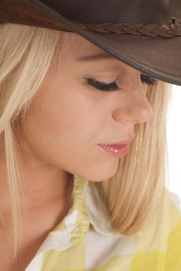 Cowgirl close head hat green plaid look down stock photography