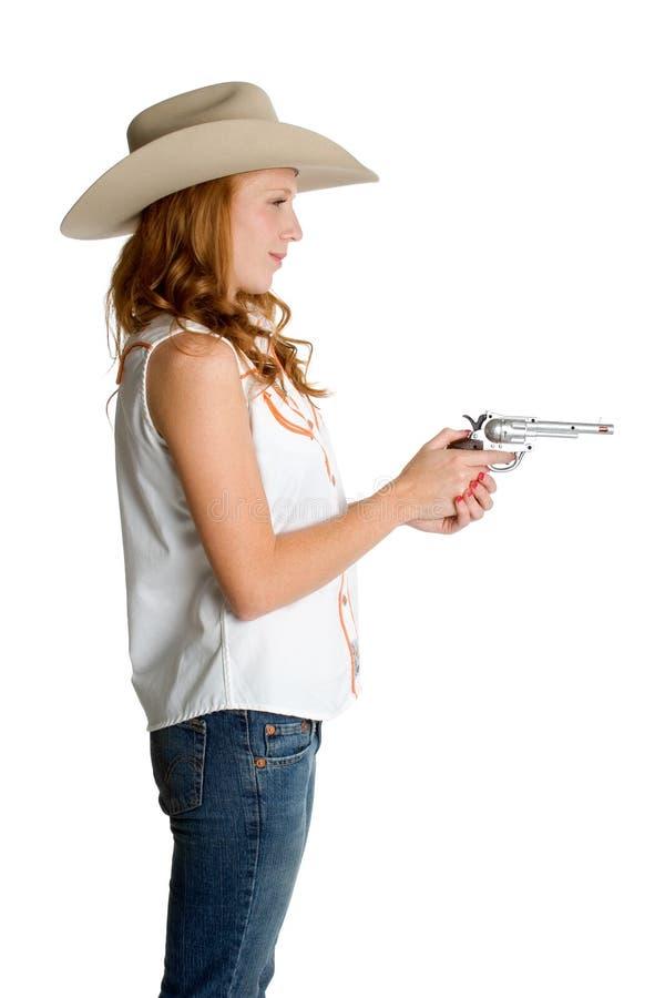 Cowgirl con el arma imagen de archivo libre de regalías