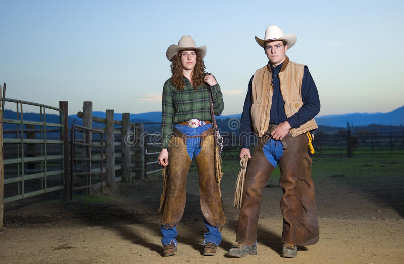 Cowgirl and cowboy couple stock photography