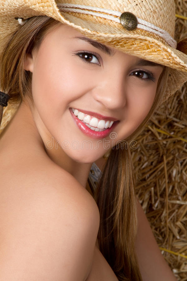 Cowgirl de sorriso imagem de stock