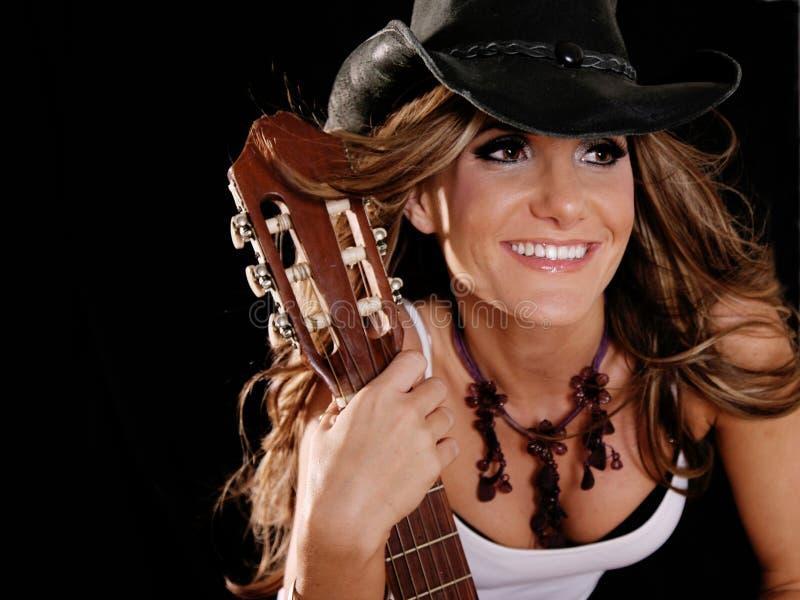 Cowgirl de sorriso bonito fotos de stock royalty free