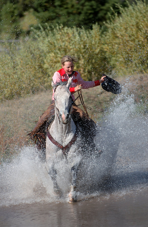 Free Cowgirl Galloping Through Pond Royalty Free Stock Photo - 263235