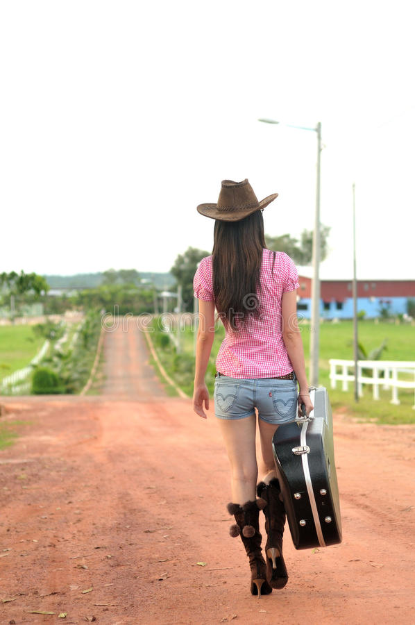 Cowgirl going home stock image