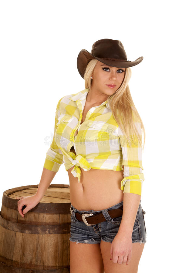 Cowgirl green plaid shirt barrel serious stock image
