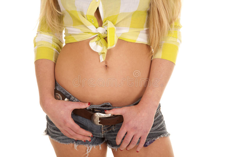 Cowgirl green plaid shirt body both thumbs in shorts royalty free stock photo