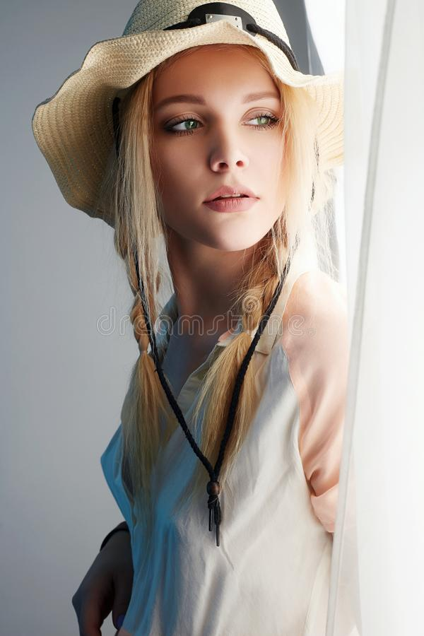 Cowgirl in Hat. Beauty Young Blonde stock photo