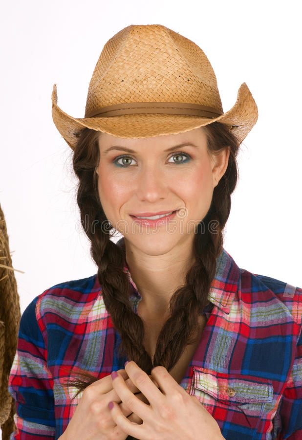 Cowgirl Pretty Girl Holds Braided Ponytails stock photos