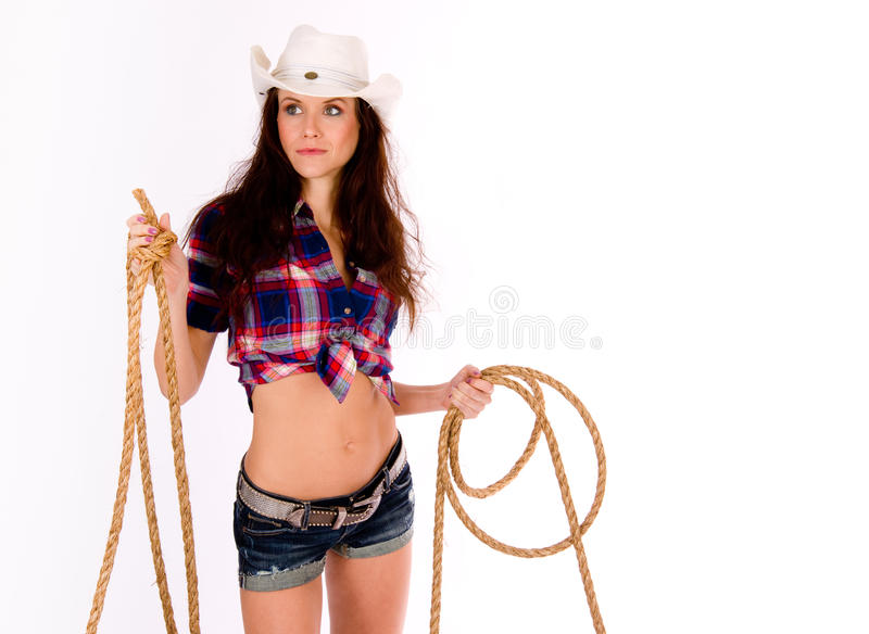 CowGirl Holds Lasso Shorts White Cowboy Hat royalty free stock photos