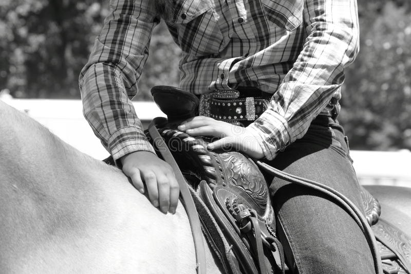 Cowgirl on horse resting stock photo