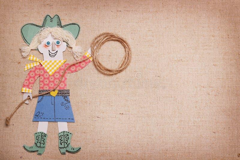 Cowgirl i västra kläder med cowboylasson i händer papperssnitt royaltyfri fotografi