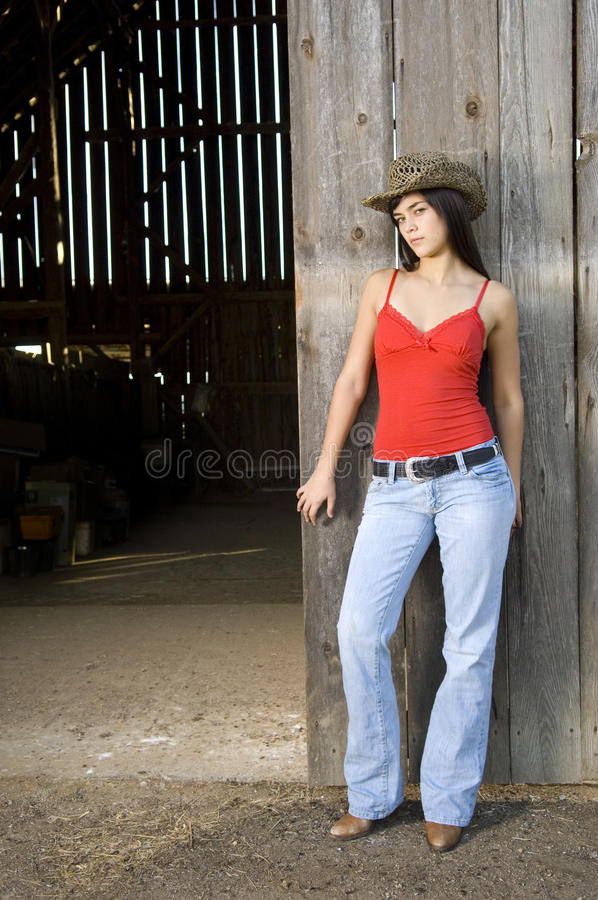 Free Cowgirl In Barn Doorway Stock Photo - 14249770