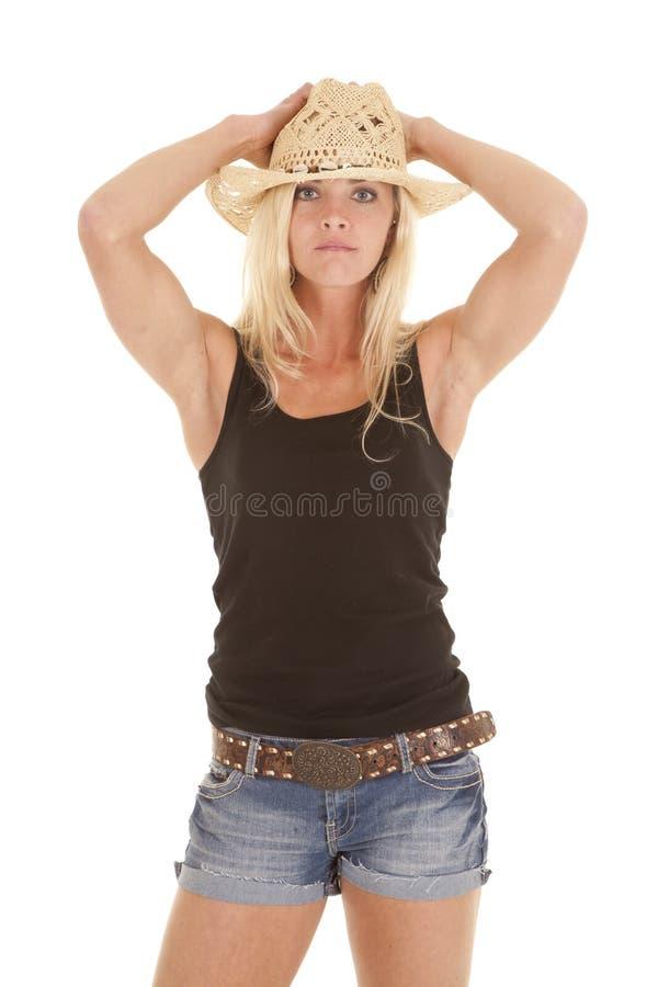 Cowgirl Levi zwiera ręki kapeluszowe obraz stock