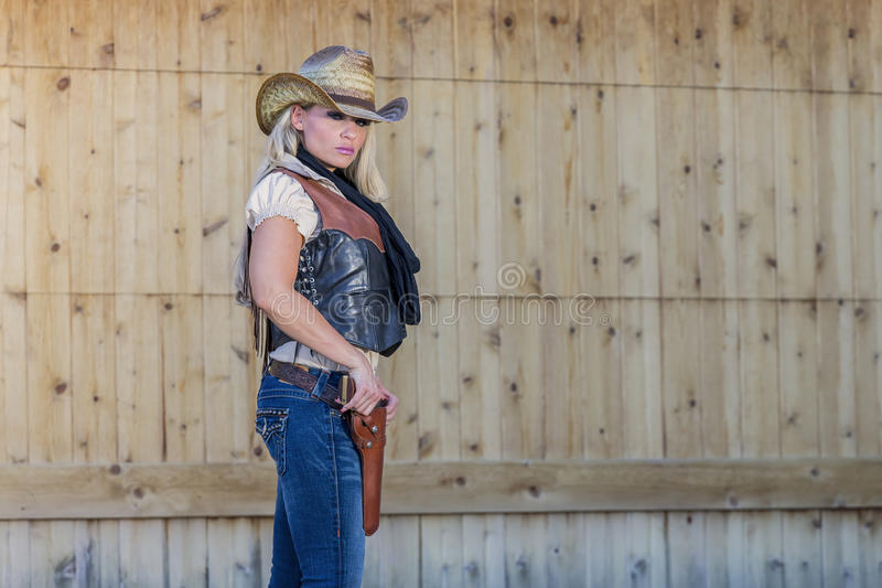 Cowgirl louro 'sexy' imagens de stock