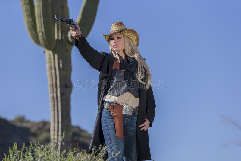 Cowgirl louro 'sexy' fotografia de stock royalty free