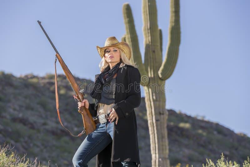 Cowgirl louro 'sexy' fotos de stock