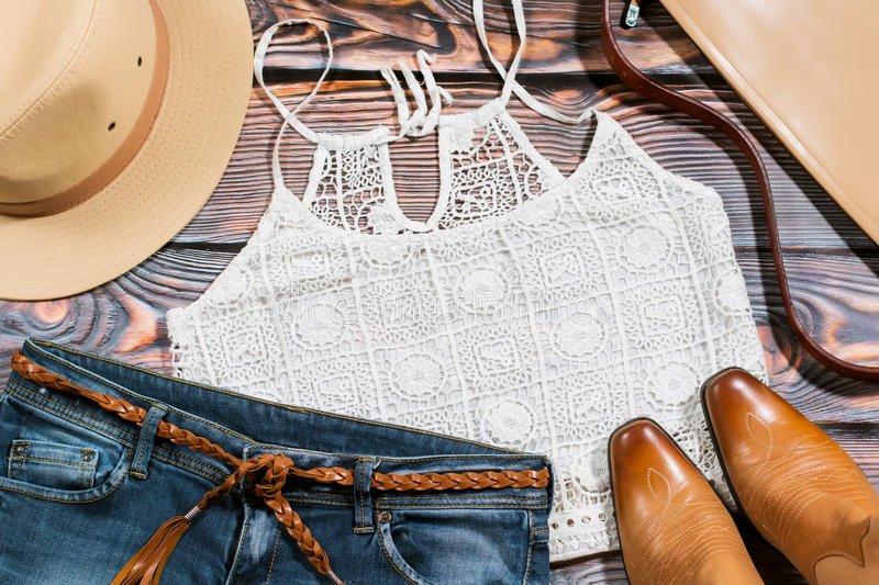 Cowgirl outfit - overhead of trendy casual woman clothes stock photography