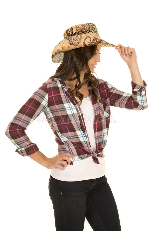 Cowgirl in plaid shirt and hat side touch hat stock image
