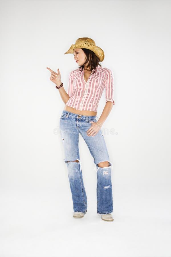 Cowgirl que aponta o dedo imagem de stock